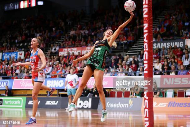 Kaylia Stanton of the Fever catches the ball next to Sarah Klau of the Swifts during the round 11 Super Netball match between the Swifts and the...