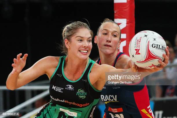Kaylia Stanton of the Fever reaches for the ball during the round four Super Netball match between the Vixens and the Fever at Hisense Arena on March...