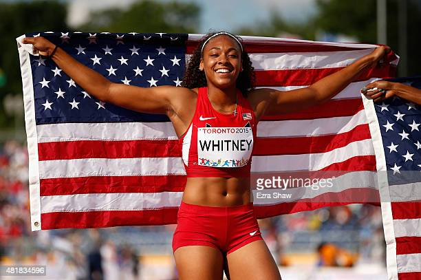 Kaylin Whitney of the United States holds the American flag after winning the women's 200 meter final on Day 14 of the Toronto 2015 Pan Am Games on...