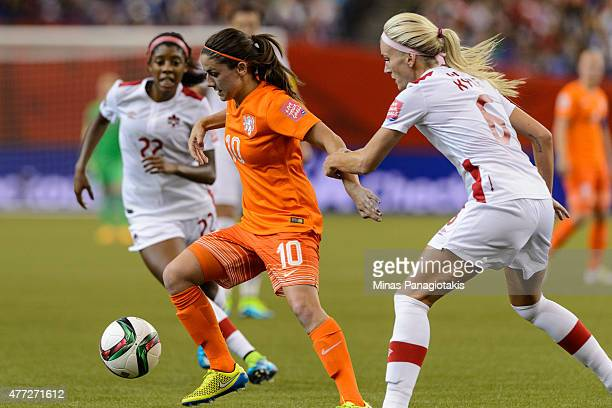 Kaylyn Kyle of Canada holds the arm of Danielle Van De Donk of the Netherlands during the 2015 FIFA Women's World Cup Group A match at Olympic...