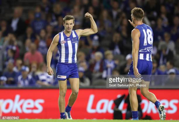 Kayne Turner of the Kangaroos celebrates after kicking a goal during the round six AFL match between the North Melbourne Kangaroos and the Gold Coast...