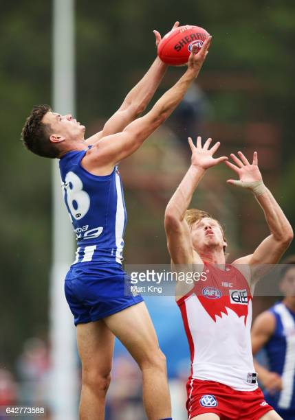 Kayne Turner of the Kangaroos competes for the ball against Callum Mills of the Swans during the 2017 JLT Community Series match between the Sydney...
