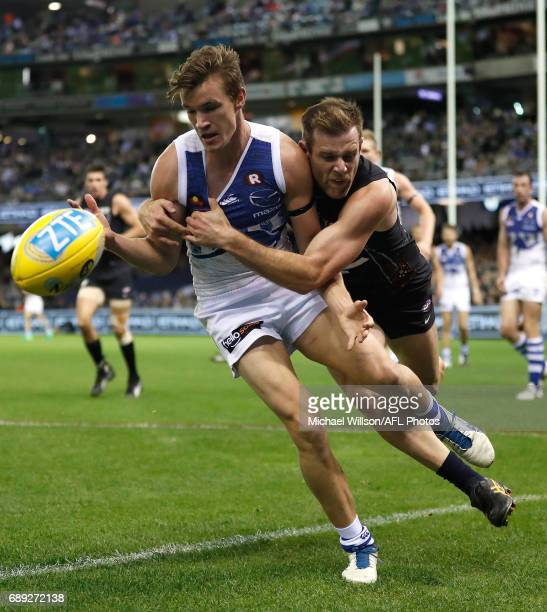 Kayne Turner of the Kangaroos is tackled by Sam Docherty of the Blues during the 2017 AFL round 10 match between the Carlton Blues and the North...