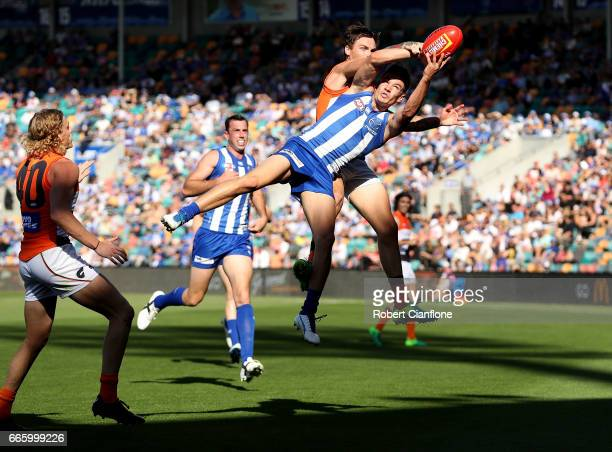 Kayne Turner of the Kangaroos takes the ball during the round three AFL match between the North Melbourne Kangaroos and the Greater Western Sydney...