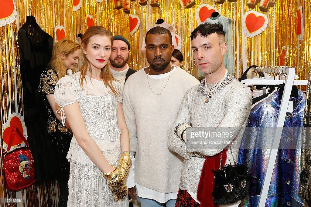 Kayne West, centre, poses with fashion designers Edward Meadham (2nd from left) and Benjamin Kirchhoff (R) and a model at LVMH Prize Semi-Finalists Designers Cocktail Party on February 26, 2014 in Paris, France.