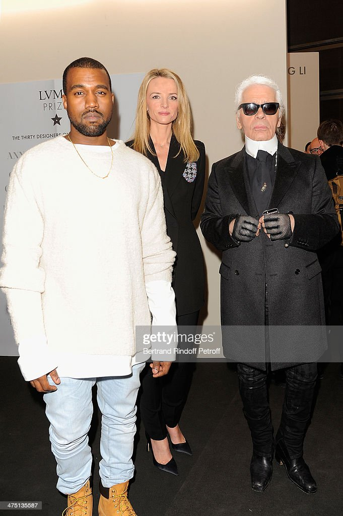 Kayne West, Delphine Arnault and Karl Lagerfeld attend LVMH Prize Semi-Finalists Designers Cocktail Party on February 26, 2014 in Paris, France.