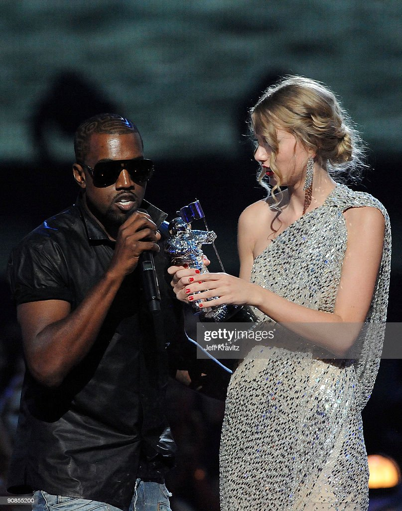 Kayne West jumps onstage as Taylor Swift accepts her award for the 'Best Female Video' award during the 2009 MTV Video Music Awards at Radio City...
