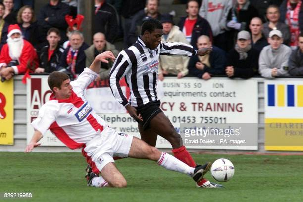 Kayode Odejayi of Forest Green Rovers gets away from Exeter's George Pilkington during their AXA Sponsored FA Challenge Cup First Round match at The...
