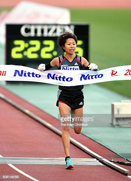 Kayoko Fukushi of Japan crosses the finishing tape to win the Osaka Women's Marathon at the Nagai Stadium on January 31 2016 in Osaka Japan