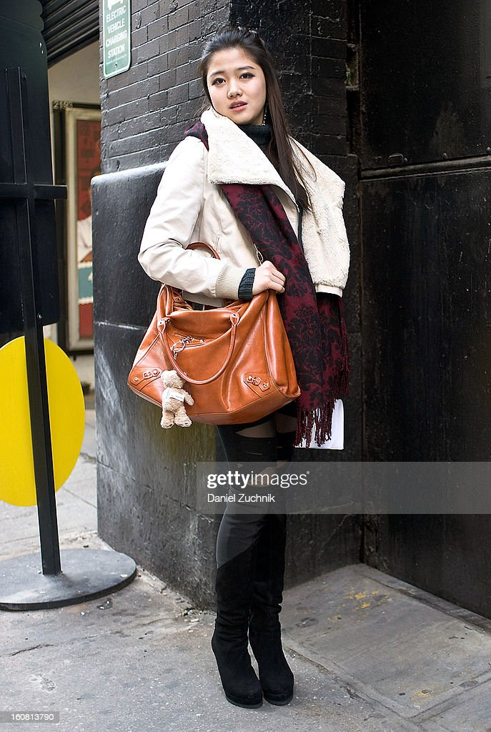 Kayoko Hashimoto, a student from Japan, is seen outside the Patrick Ervell show wearing an Alexander Wang skirt, B.B.B. leggings, vintage coat, Moussy scarf and vintage bag on February 6, 2013 in New York City.
