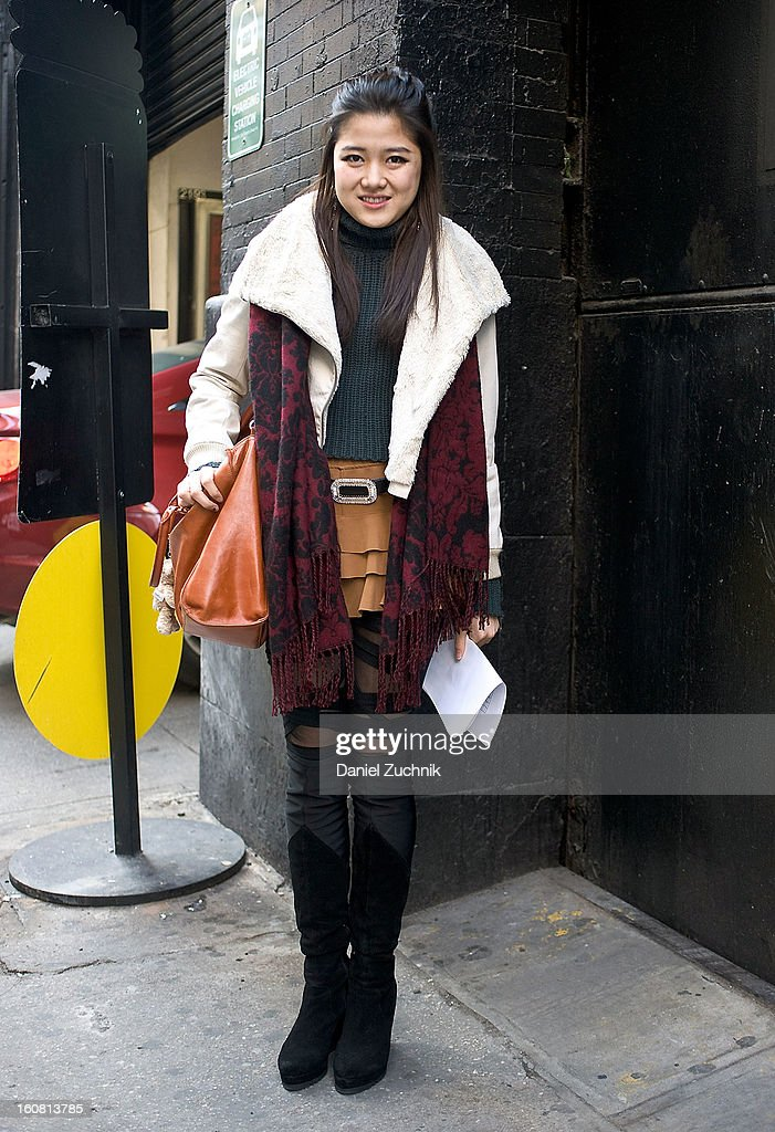 Kayoko Hashimoto, student from Japan, is seen outside the Patrick Ervell show wearing an Alexander Wang skirt, B.B.B. leggings, vintage coat, Moussy scarf and vintage bag on February 6, 2013 in New York City.