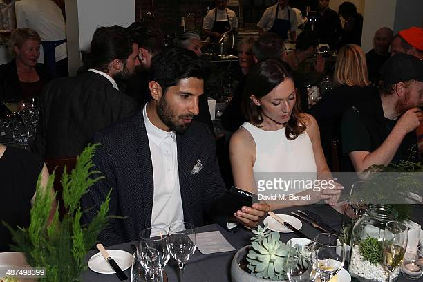 Kayvan Novak and Virginia Norris attend the Whistles menswear launch dinner on April 30 2014 in London England
