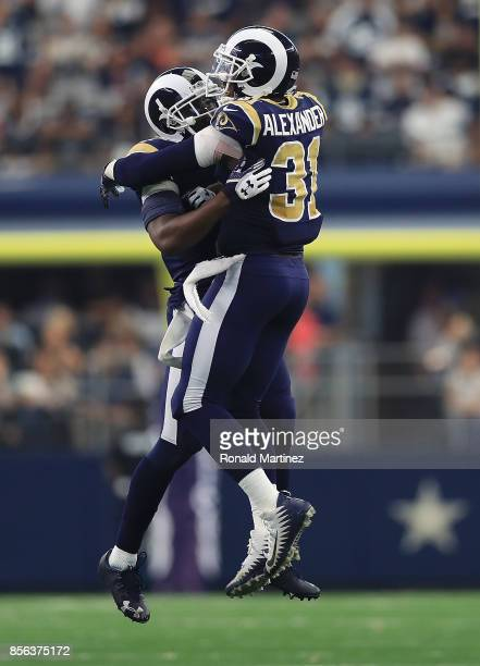 Kayvon Webster and Maurice Alexander of the Los Angeles Rams celebrate after a turnover on downs by the Dallas Cowboys in the fourth quarter at ATT...