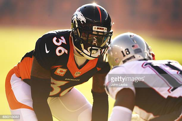 Kayvon Webster of the Denver Broncos lines up Matthew Slater of the New England Patriots during the first quarter on Sunday December 18 2016 The...