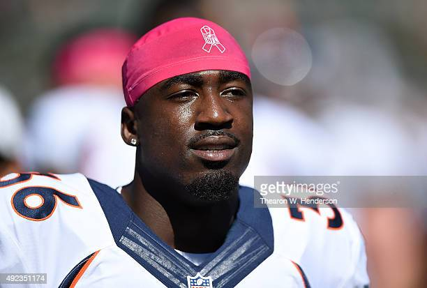 Kayvon Webster of the Denver Broncos looks on during pregame prior to playing the Oakland Raiders at the Oco Coliseum on October 11 2015 in Oakland...