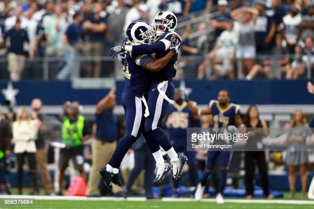 Kayvon Webster of the Los Angeles Rams celebrates with Maurice Alexander of the Los Angeles Rams after the Los Angeles Rams beat the Dallas Cowboys...