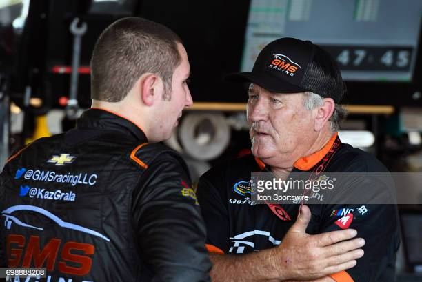 Kaz Grala Chevrolet Silverado talks with his crew after the final practice session for the NASCAR Camping World Truck Series Drivin' for Linemen 200...