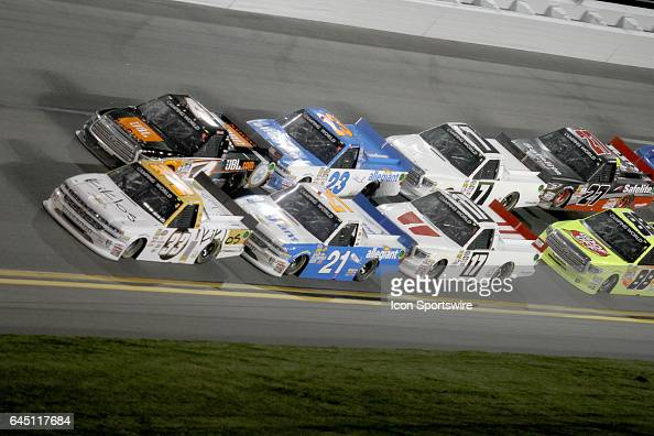 Kaz Grala driver of the Kiklos Chevy leads the field through turn 4 during the running of NASCAR Camping World Truck Series NextEra Energy Resources...