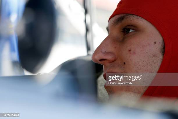 Kaz Grala driver of the Kiklos Greek Extra Virgin Olive Oil Chevrolet sits in his truck during practice for the NASCAR Camping World Truck Series...