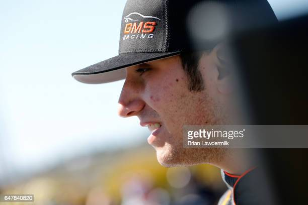 Kaz Grala driver of the Kiklos Greek Extra Virgin Olive Oil Chevrolet stands on the grid during qualifying for the NASCAR Camping World Truck Series...