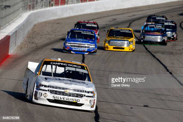 Kaz Grala driver of the Kiklos Greek Extra Virgin Olive Oil Chevrolet leads a pack of trucks during the NASCAR Camping World Truck Series Active Pest...
