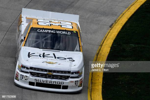Kaz Grala driver of the Kiklos Greek Extra Virgin Olive Oil Chevrolet practices for the NASCAR Camping World Truck Series Alpha Energy Solutions 250...