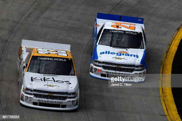 Kaz Grala driver of the Kiklos Greek Extra Virgin Olive Oil Chevrolet and Johnny Sauter driver of the Allegiant Travel Chevrolet practice for the...
