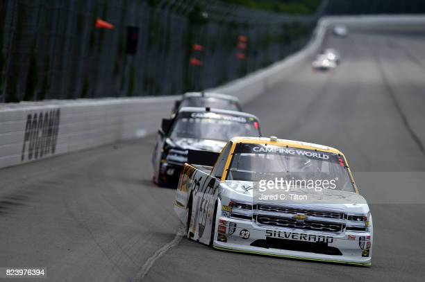 Kaz Grala driver of the Kiklos Greek Extra Virgin Olive Oil Chevrolet leads a pack of trucks during practice for the NASCAR Camping World Truck...