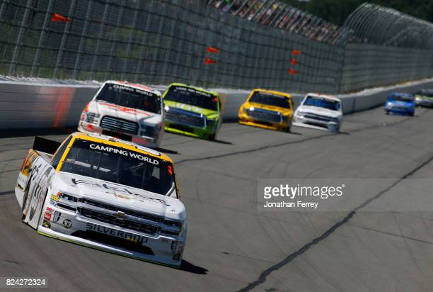 Kaz Grala driver of the Kiklos Greek Extra Virgin Olive Oil Chevrolet leads a pack of cars during the NASCAR Camping World Truck Series Overton's 150...