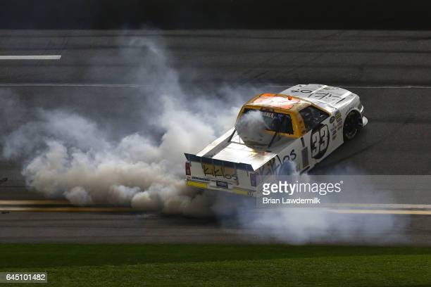 Kaz Grala driver of the KiklosGreekExtraVirginOliveOil Chevrolet celebrates with a burnout after winning during the NASCAR Camping World Truck Series...