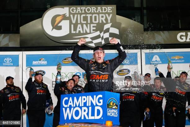 Kaz Grala driver of the KiklosGreekExtraVirginOliveOil Chevrolet celebrates in Victory Lane after winning the NASCAR Camping World Truck Series...
