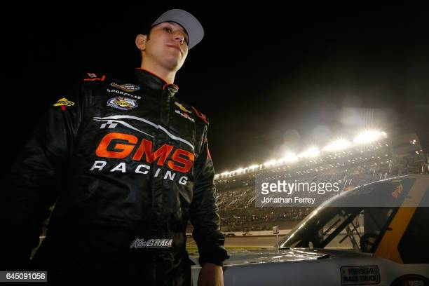Kaz Grala driver of the KiklosGreekExtraVirginOliveOil Chevrolet stands on the grid during the NASCAR Camping World Truck Series NextEra Energy...