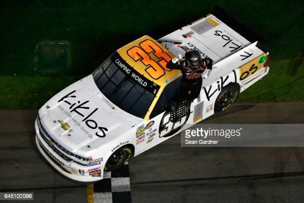 Kaz Grala driver of the KiklosGreekExtraVirginOliveOil Chevrolet celebrates after winning the NASCAR Camping World Truck Series NextEra Energy...