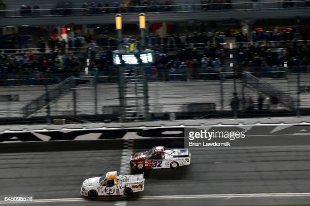 Kaz Grala driver of the KiklosGreekExtraVirginOliveOil Chevrolet crosses the finish line to win during the NASCAR Camping World Truck Series NextEra...