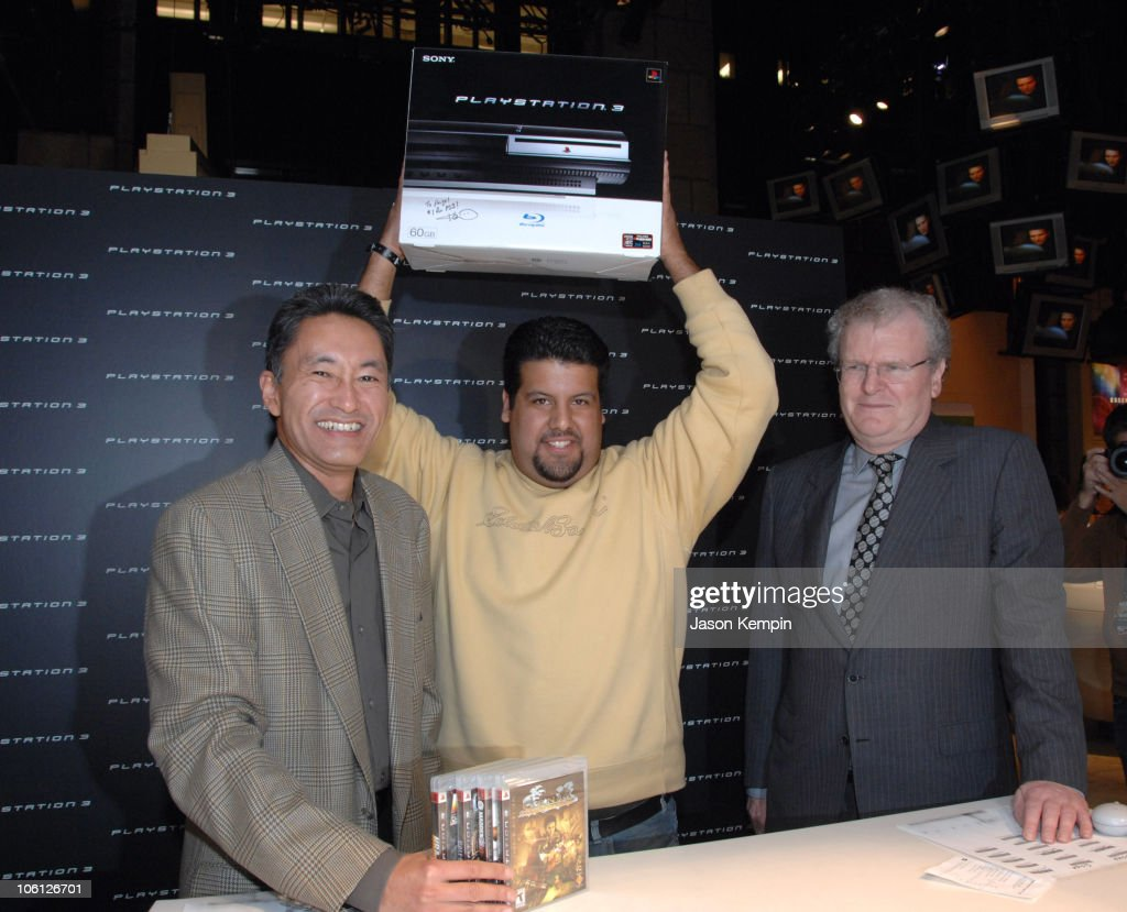 Kaz Hirai, President of Sony Computer Entertainment America, Angel Paredes, first Playstation 3 owner and Sir <a gi-track='captionPersonalityLinkClicked' href=/galleries/search?phrase=Howard+Stringer&family=editorial&specificpeople=210597 ng-click='$event.stopPropagation()'>Howard Stringer</a>, Chairman and Chief Executive Officer 0f Sony Corporation