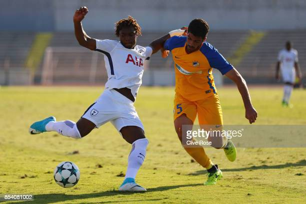 Kazaiah Sterling of Tottenham Hotspur holds off Zacharias Adoni of APOEL Nicosia as he shoots during UEFA Youth League Group H match between Apoel...