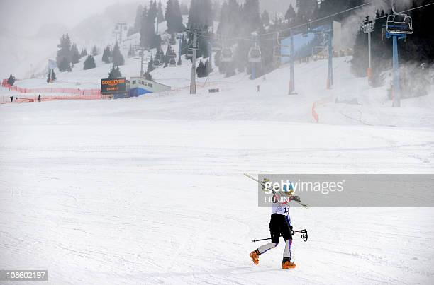 A Kazakh athlete from the alping skiing team walks on the snow at the Shymbulak Alpine Resort in Almaty on January 30 2011 The Asian Winter Games...