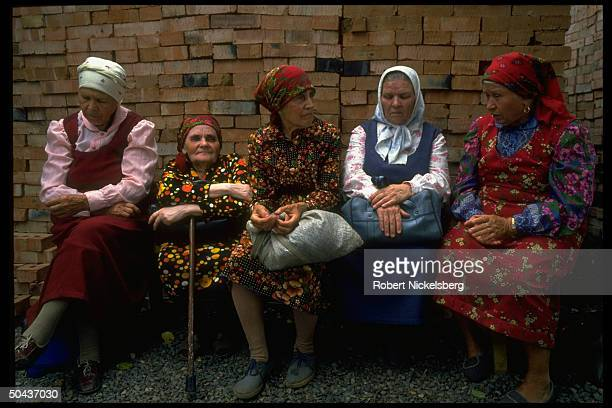 Kazakh babushkas sitting outside church chatting