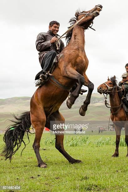 Kazakh Man Rearing Horse