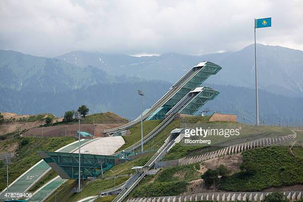 A Kazakh national flag flies at the Sunkar International Ski Jumping Complex in Almaty Kazakhstan on Tuesday June 23 2015 Kazakhstan completed its...