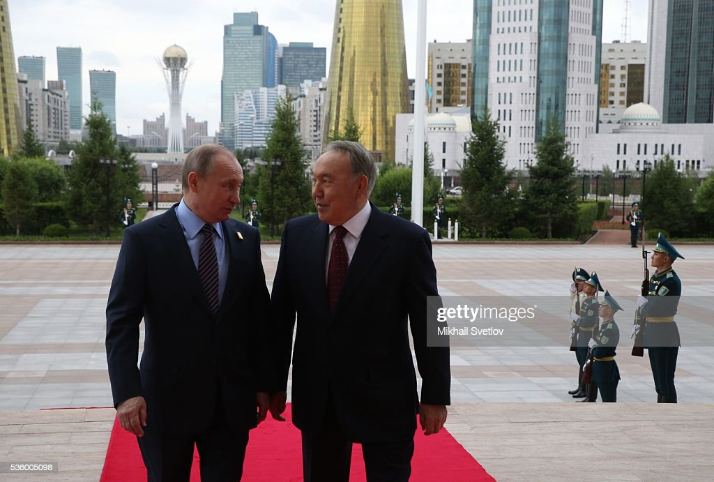 ASTANA, KAZAKHSTAN - MAY, 31 (RUSSIA OUT) Kazakh President <a gi-track='captionPersonalityLinkClicked' href=/galleries/search?phrase=Nursultan+Nazarbayev&family=editorial&specificpeople=4556028 ng-click='$event.stopPropagation()'>Nursultan Nazarbayev</a> (R) and Russian President <a gi-track='captionPersonalityLinkClicked' href=/galleries/search?phrase=Vladimir+Putin&family=editorial&specificpeople=154896 ng-click='$event.stopPropagation()'>Vladimir Putin</a> (L) seen during the Eurasian Economic Union Summit at Akorda Palace on May 31, 2016 in Astana, Kazakhstan. Heads of the Eurasian Economic Union (EAEU) member states Russia, Belarus, Armenia, Kazakhstan and Kyrgyzstan have gathered in Astana for the summit. President Putin will also hold talks with Kazakh President <a gi-track='captionPersonalityLinkClicked' href=/galleries/search?phrase=Nursultan+Nazarbayev&family=editorial&specificpeople=4556028 ng-click='$event.stopPropagation()'>Nursultan Nazarbayev</a>.