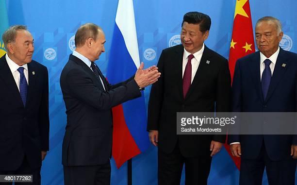 Kazakh President Nursultan Nazarbayev Russian President Vladimir Putin Chinese President Xi Jinping and Uzbek President Islam Karimov pose for a...