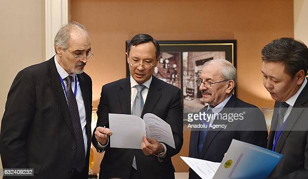 Kazakhstan Foreign Minister Kairat Abdrakhmanov speaks with the Syrian regime representatives ahead of Syria peace talks in Astana Kazakhstan on...