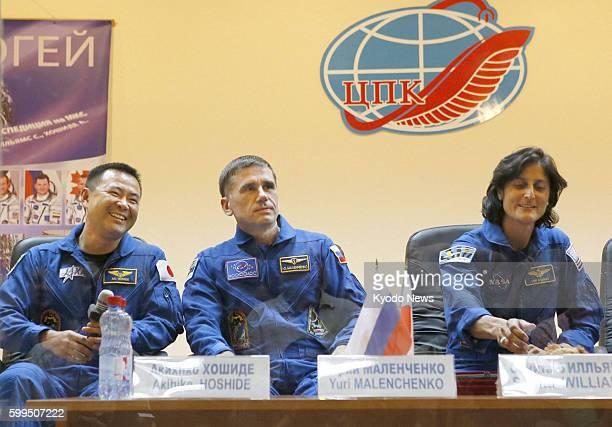 BAIKONUR Kazakhstan Japanese astronaut Akihiko Hoshide Russian cosmonaut Yuri Malenchenko and NASA astronaut Sunita Williams attend a press...