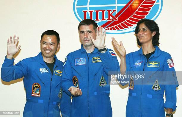 BAIKONUR Kazakhstan Japanese astronaut Akihiko Hoshide Russian cosmonaut Yuri Malenchenko and NASA astronaut Sunita Williams wave after a press...