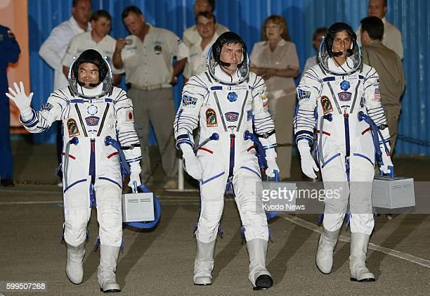BAIKONUR Kazakhstan Japanese astronaut Akihiko Hoshide Russian cosmonaut Yuri Malenchenko and NASA astronaut Sunita Williams head for a ceremony to...