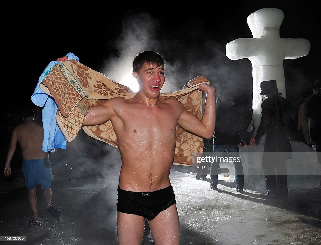 Kazakhstan Orthodox church's faithful celebrates the Epiphany by plunging into the ice cold water of a river in Pavlodar early on January 19, 2012 as the air temperature dropped down to -27 degrees Celsius.