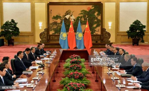 Kazakhstan President Nursultan Nazarbayev and Chinese President Xi Jinping attend their meeting at the Great Hall of People on the sidelines of the...