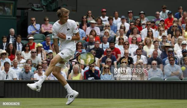 Kazakhstan's Alexander Bublik play a shot through his legs to Britain's Andy Murray during their men's singles first round match on the first day of...
