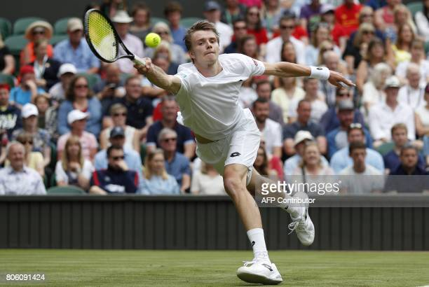 Kazakhstan's Alexander Bublik returns to Britain's Andy Murray during their men's singles first round match on the first day of the 2017 Wimbledon...